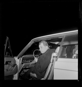 Attorney F. Lee Bailey getting into his vehicle to drive