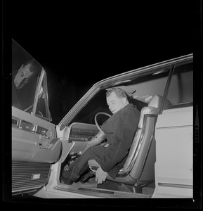 Criminal defense attorney F. Lee Bailey getting into his vehicle to drive