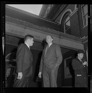 Assistant District Attorney Donald Conn and forensic psychiatrist Dr. Ames Robey in discussion in front of the courthouse