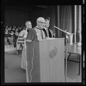 Abram L. Sachar, founding president of Brandies University, speaking at podium during commencement