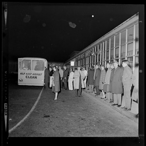 Group of people standing outside an airline terminal at the airport