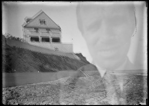 Double exposure: person's face, house on hill - not known