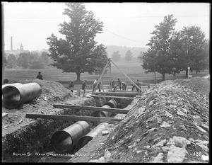 Distribution Department, Low Service Pipe Lines, laying pipe at upper end of trench, on Beacon Street, near Chestnut Hill Reservoir, looking west, Boston, Mass., May 29, 1896
