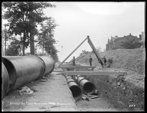 Distribution Department, Low Service Pipe Lines, laying double line of 48-inch pipes on Beacon Street, near Winthrop Road, from the east, Brookline, Mass., Jul. 6, 1896