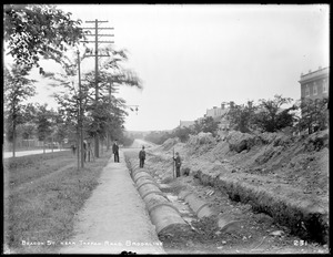 Distribution Department, Low Service Pipe Lines, raising the pipe on Beacon Street, near Tappan Road, Brookline, Mass., Jul. 6, 1896