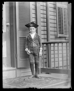 Unidentified boy in costume with sword