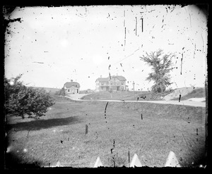 Distant view of unidentified house and barn