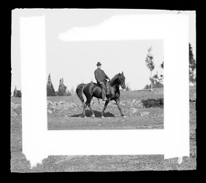 Unidentified man on horse