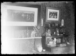 Scene of one wall inside a home with desk and pictures