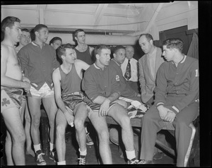 Auerbach and other Celtics listen to Tom Heinsohn