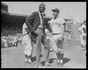 Bill Russell talking with Yankee player at Fenway Park