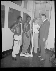 Jimmy Carter, on scale, and challenger Bud Smith weigh in before lightweight fight, Boston Garden