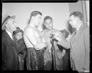 Al McCoy weighs in while Joe Louis looks on, at Boston Garden