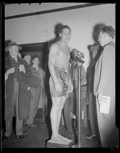 Joe Louis weighs in before McCoy fight at the Garden