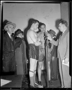 Joe Louis watches Al McCoy weigh in before fight at the Garden
