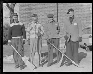 Curling: Four curlers with brooms