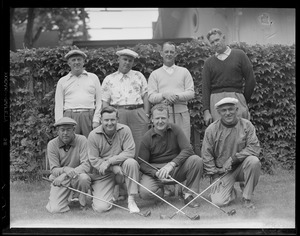 8 men with golf clubs
