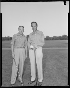 Two men pose on course