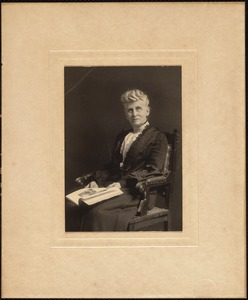 Woman seated in chair portrait