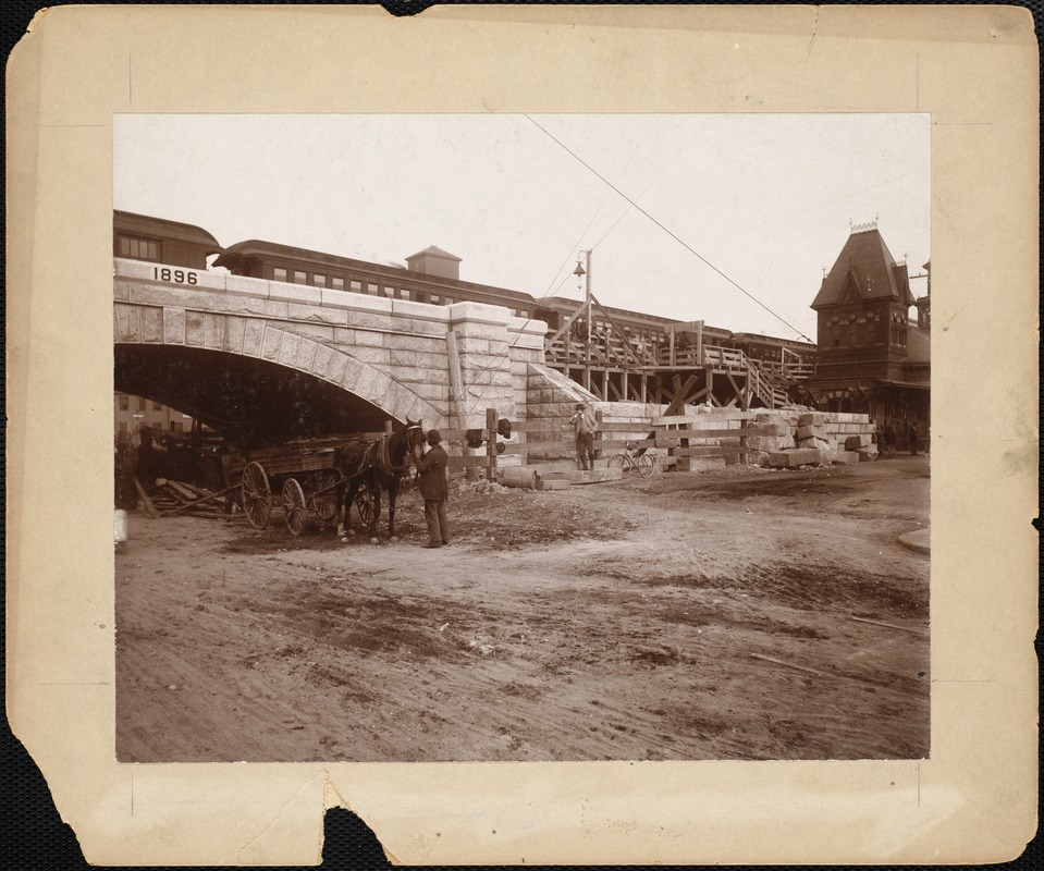Railroad during construction with train at depot