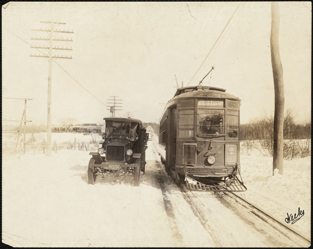 Electric street car (N. Easton line) and automobile