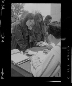 Students at Boston University register to vote at facilities set up on their campus by the City of Boston