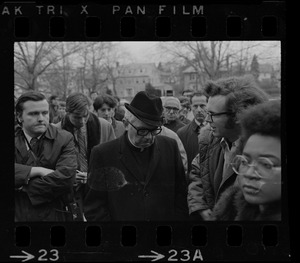 Rev. F.X. Shea, Executive Vice-President of Boston College, seen in middle of crowd during Boston College sit-in