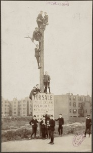 Young fans climb pole next to Huntington Avenue Grounds, 1903 World Series