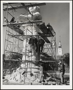 """Dartmouth students building 35 foot ice statue """"Fire and Ice,"""" theme statue of 1957 Dartmouth College Winter Carnival."""