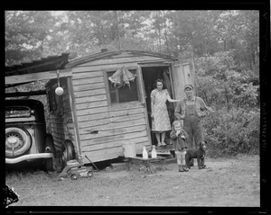"""Mr. & Mrs. Lampi, daughter Ruth, 2 1/2, with dog """"Nigger"""" living near the mill at Long Pond in West Rutland"""