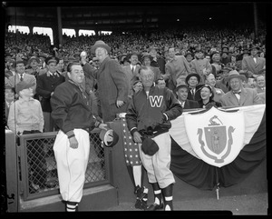 Gov. Herter throws out the first ball as Lou Boudreau, Red Sox manager, and Bucky Harris, Senators Manager, look on.