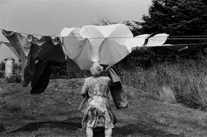 Woman and wind-blown clothesline, Monhegan Island, Maine