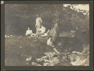 Kunhardt family and friends picnicking by a stream