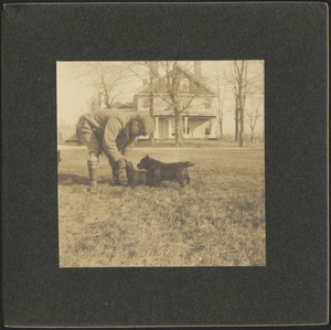 Ashdale Farm. Unidentified man with two dogs in yard.