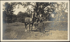 Gertrude S. Kunhardt with horse in garden, Ashdale Farm.