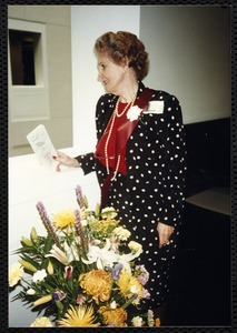 Newton Free Library, 330 Homer St., Newton, MA. 9/14/1991 gala preview, the evening before opening. Woman with flowers