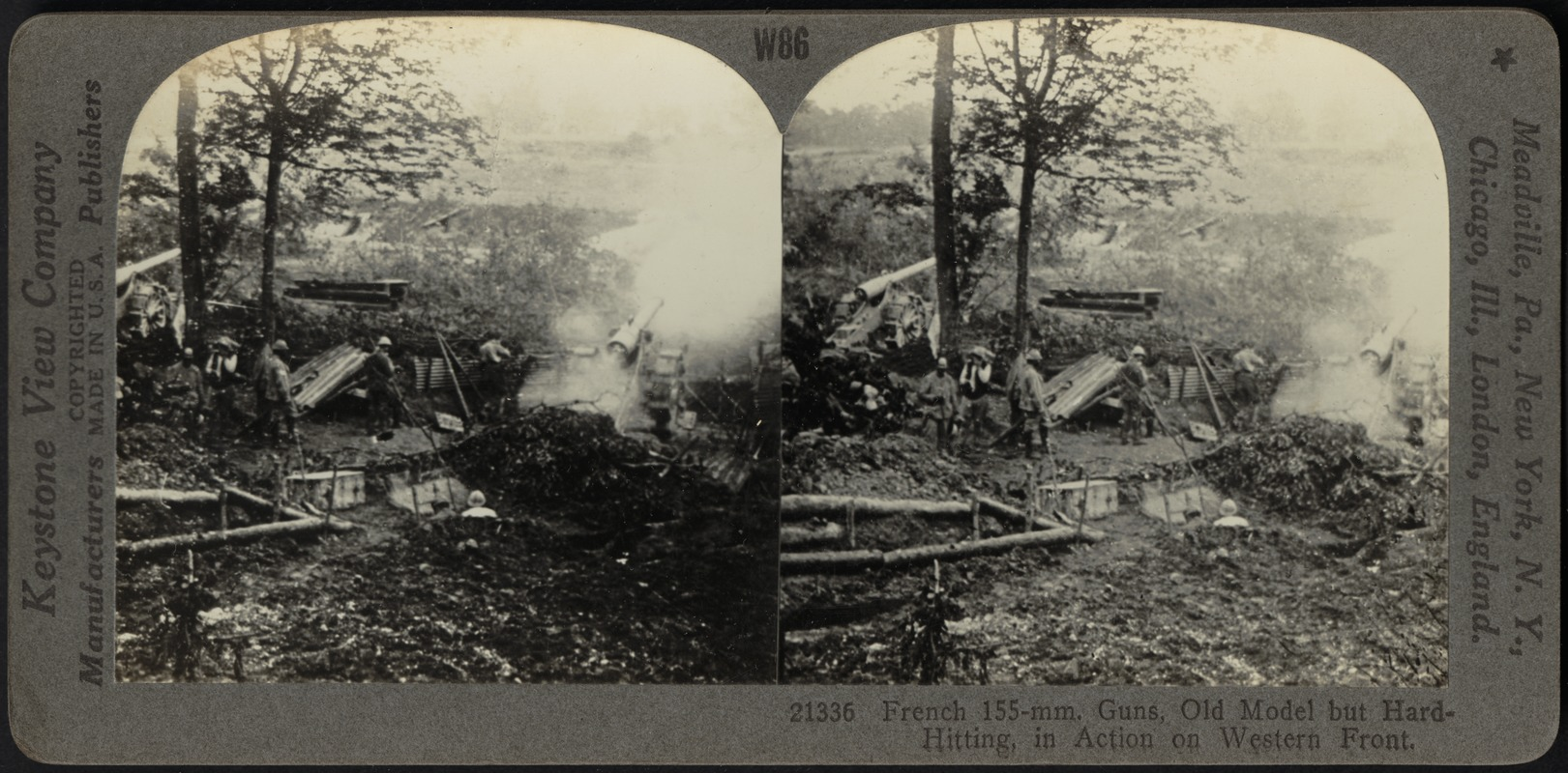 A battery of 155-mm. field guns in action on the western front