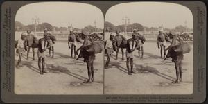 Welcome fellows in thirsty India - water-carriers at Calcutta, India