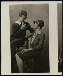 Young man with pipe, young woman with hat