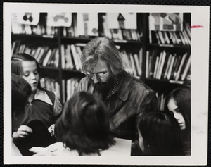 Mike Frith reading to children