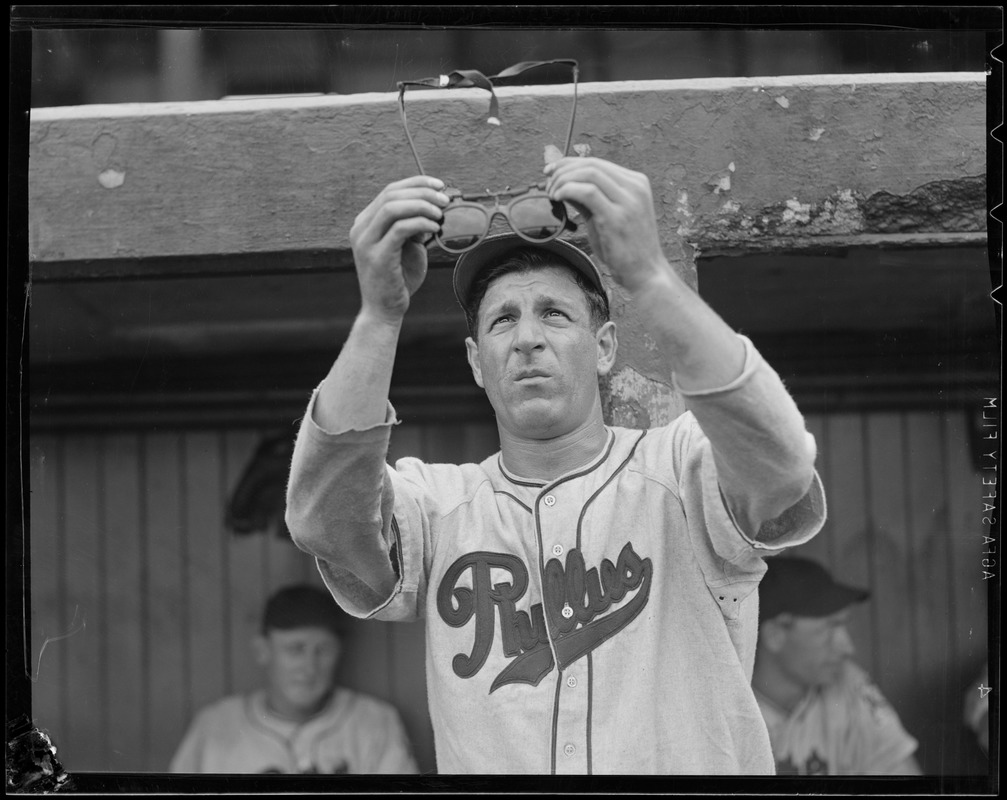 Philadelphia Phillies player examines his glasses