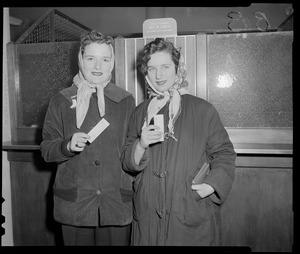 Women holding Red Sox tickets