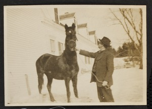 Portrait of man with horse