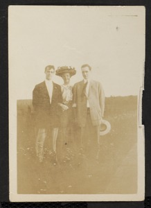 Portrait of two men and a woman