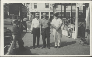 Men outside Dave Harnch's antique shop, Liberty and State Sts.
