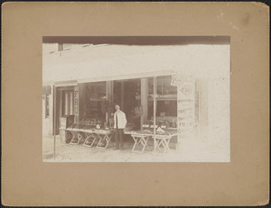 Hiram Watts in front of his store on Pleasant St.