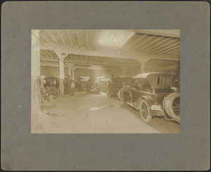 Corner of Prospect and State St., interior of garage, 1920