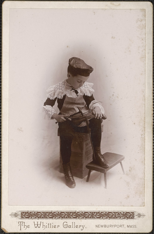 Young lad dressed in a highly decorative outfit