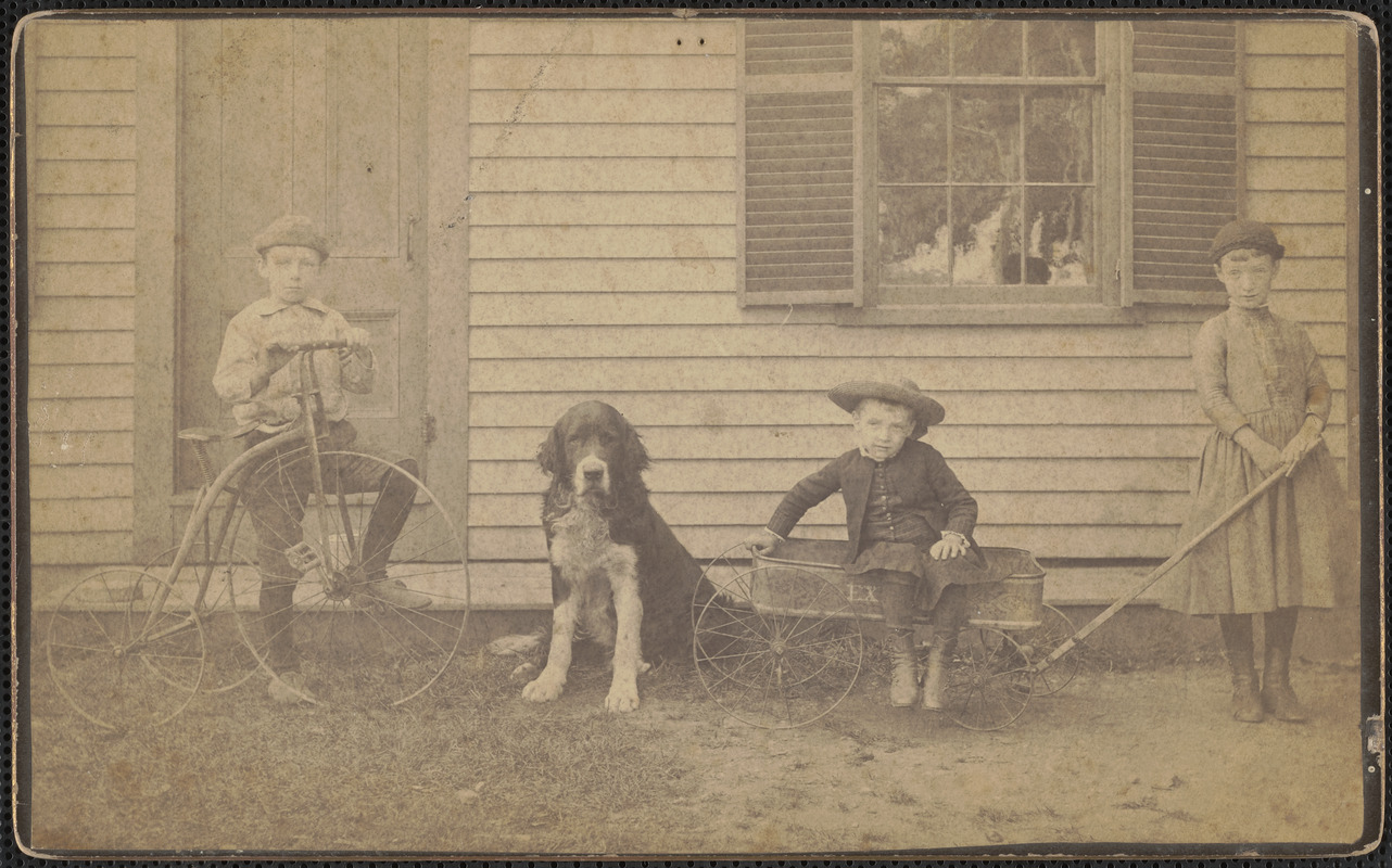 Two boys, one girl, with dog