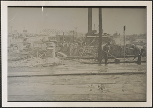 Cleaning up after Dodge Bros. Fire, May 19, 1934